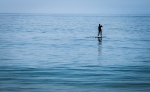 a_photo_of_a_single_paddle_surfer